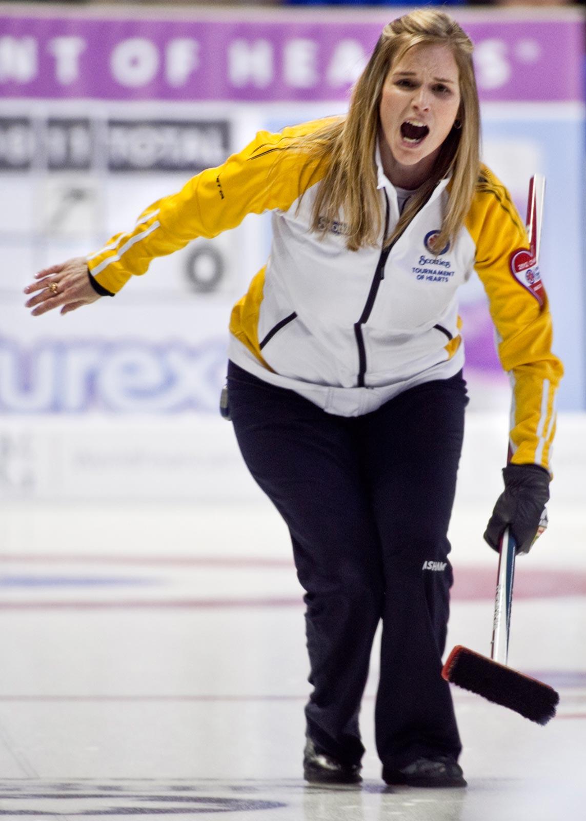 Jennifer Jones helps with her shot…